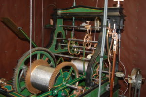 green clock with pulley