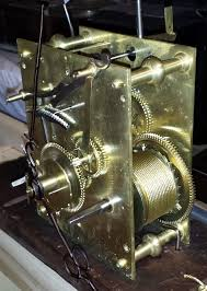 gold standing clock with gears